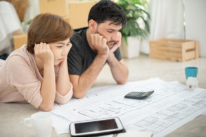 Couple deciding what type of home to purchase.